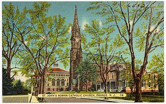 Columbus Hall, Orange, New Jersey - Postcard showing Columbus Hall (St. John's School) and the parish church. ca 1935.