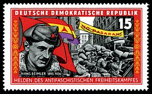 Hans Beimler (communist) - Hans Beimler and fight scene of the International Brigades in the background as depicted on an East German stamp