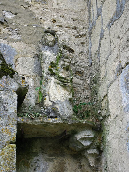 Statue on the right of the portal of the Notre-Dame church, in Arcis-le-Ponsart (France, 51)