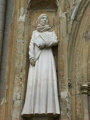 Julian of Norwich - Statue of Julian on the front of Norwich Cathedral, holding the book Revelations of Divine Love