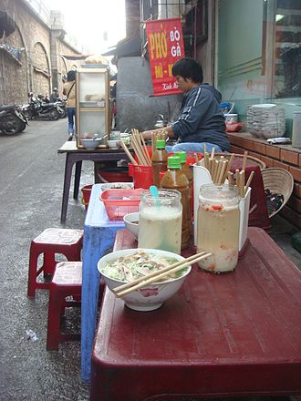 Pho - Chicken pho at a typical street stall in Hanoi. The lack of side garnishes is typical of northern Vietnamese-style cooking.