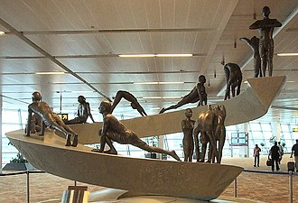Surya Namaskār - Sculpture of the 12 asanas of Surya Namaskar in IGIA Airport.