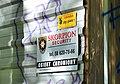 Tablica na ścianie płotu w opuszczonym sanatorium w Gdyni.jpg