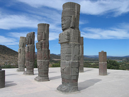 "Columnar statues in the form known as the ""Atlantean figures"" or ""Atlantids"", representing Toltec warriors. The examples shown here are from the Toltec site of Tula (Tollan), north of Mexico City; similar examples and styles found at Chichen Itza by Morley provided further evidence of Maya cultural exchange with central Mexico. Telamones Tula.jpg"