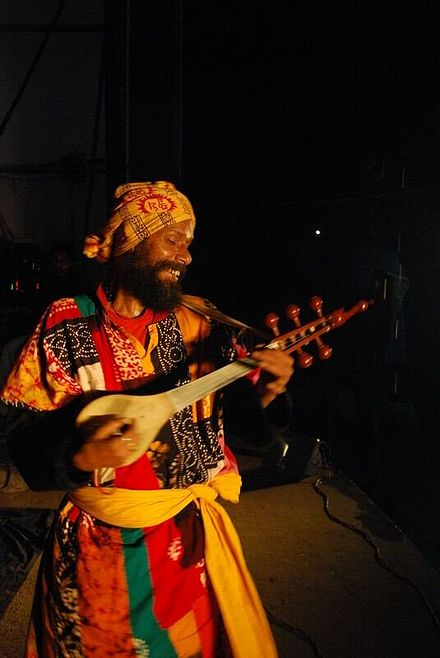 A Baul musician. The Baul ballads of Bengal are classified by UNESCO as humanity's intangible cultural heritage Tharundas baul.jpg