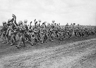Worcestershire Regiment - Men of the 4th Battalion, Worcestershire Regiment marching to the trenches; Acheux-en-Amiénois, France, 27 June 1916.