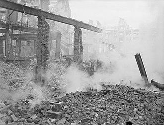 Fore Street, London - Inspecting bomb damage, January 1941