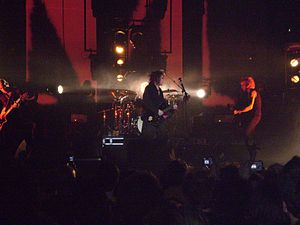 Music of the United Kingdom (1980s) - The Cure on stage in 2008.