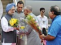 The Prime Minister, Dr. Manmohan Singh being welcomed by the Governor of West Bengal, Shri M.K. Narayanan, on his arrival, at Netaji Subhash Chandra Bose International Airport, in Kolkata, West Bengal on June 02, 2012.jpg