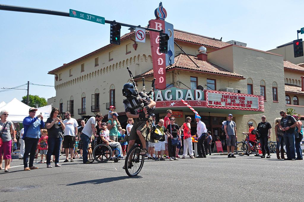 The Unipiper entertaining a crowd gathered in front of the Bagdad Theater in Portland, Oregon
