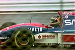 Thierry Boutsen - Jordan 193 heads for Copse during practice for the 1992 British Grand Prix (33302736680).jpg
