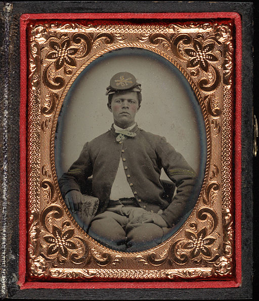 Three quarter portrait, young Civil War soldier in kepi. Cased tintype, ninth plate
