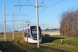 Tram arriving at The Gyle (2) (geograph 4326344).jpg