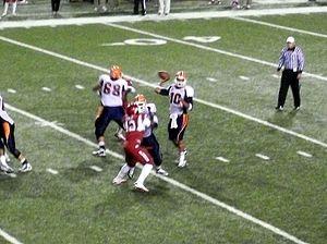 UTEP Miners football - UTEP quarterback Trevor Vittatoe attempts a pass against the Arkansas Razorbacks in 2010, game played in Razorback Stadium, Fayetteville, Arkansas, USA
