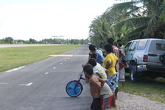 Funafuti International Airport - Tuvaluan children watching a plane land at Funafuti International Airport