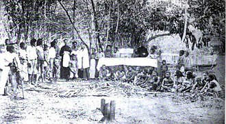 Mindanao - Two Spanish missionaries baptizing a Moro convert to Roman Catholicism, circa 1890.