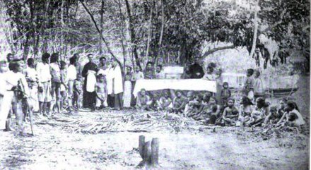 Two Spanish missionaries baptising a Moro convert to Roman Catholicism, circa 1890. Two Spanish missionaries baptise a Moro convert to Roman Catholic, circa 1890.jpg