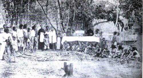 Two Spanish missionaries baptise a Moro convert to Roman Catholic, circa 1890