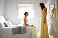 Two women wearing wedding dresses.jpg