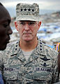 U.S. Air Force Gen. Douglas Fraser, commander of U.S. Southern Command, listens to a camp leader at Ancien Aeroport Militaire in Port-au-Prince, Haiti, March 6, 2010 100306-N-HX866-017.jpg