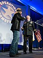 U.S. Army Gen. Martin E. Dempsey, right, the chairman of the Joint Chiefs of Staff, and Bret Michaels sing during the Operation Homefront sixth annual Military Child of the Year Award event in Arlington, Va 140410-D-KC128-212.jpg