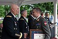 U.S. Army Gen. Ray Odierno, left, the chief of staff of the Army, shakes hands with Austrian Land Forces Col. Rudolf Zauner, the winner of an award for writing and research, during the U.S. Army War College 130608-A-AO884-076.jpg