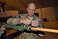 U.S. Army Lt. Col. Michael A. Tougher III, the commander of Task Force Guam, 1st Battalion, 294th Infantry Regiment, Guam Army National Guard, secures his battalion's flag Dec. 26, 2013, at Kabul International 131226-Z-WM549-010.jpg