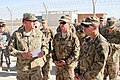 U.S. Army Sgt. 1st Class Matthew W. Biggs, front left, a retrograde noncommissioned officer in charge with the 15th Sustainment Brigade, 1st Theater Sustainment Command, gives a briefing on operations at 131007-A-NX007-001.jpg