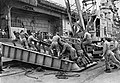 U.S. Marines load a M101 howitzer aboard USS Princeton (LPH-5), in 1960.jpg
