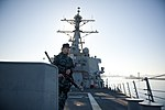 U.S. Navy Fire Controlman 2nd Class Denny Schriefer scans the perimeter of the guided missile destroyer USS Arleigh Burke (DDG 51) as he stands watch aboard the ship March 8, 2014, in Marseille, France 140308-N-WD757-079.jpg