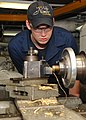 U.S. Navy Machinery Repairman Fireman Cameron Stoneking uses a lathe to turn down a brass sink fitting for a stateroom aboard the aircraft carrier USS Nimitz (CVN 68) 130117-N-BJ752-046.jpg