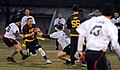 U.S. Navy Senior Chief Sonar Technician (Surface) Ben Pierson, second from left, the senior enlisted adviser for the U.S. Naval War College (NWC), runs for a first down during an Army-Navy flag football game 131206-N-PX557-278.jpg