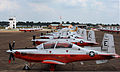 U.S. Navy T-6B Texan II training aircraft assigned to Training Wing 5 are staged on the tarmac at Millington Regional Jetport in Millington, Tenn., Aug. 28, 2012, after being evacuated from their home station 120828-N-NP779-045.jpg