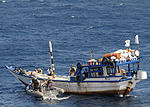 U.S. Sailors assigned to the guided-missile cruiser USS Vella Gulf (CG 72) provide aid to fishermen aboard a dhow in the Gulf of Oman Feb. 7, 2009 090207-N-RT317-056.jpg