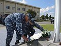 U.S. Sailors stand in formation as Information Systems Technician 1st Class Brandon M. Donaldson, left, and Logistics Specialist 1st Class Dat Do place a wreath during a 9-11 commemoration ceremony at Misawa Air 140911-N-EC644-048.jpg