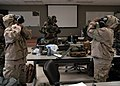 U.S. Sailors with Naval Mobile Construction Battalion (NMCB) 25 don mission-oriented protective posture gear during a simulated chemical attack during chemical, biological and radiological (CBR) team training 140214-N-JP566-019.jpg