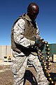 U. S. Marine Cpl. Derek White with Combat Logistics Regiment 2, 2nd Marine Logistics Group, counts ammunition at an ammunition holding area during Enhanced Mojave Viper (EMV), on Marine Corps Air Ground Combat 120912-M-KS710-008.jpg