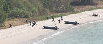 Naval Special Warfare Command (Thailand) - Navy SEALs conduct a beach assault from Zodiac inflatables during Exercise Cobra Gold 2011