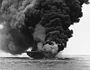 USS Bunker Hill (CV-17) afire after being hit by Kamikazes off Okinawa, 11 May 1945 (80-G-274266)