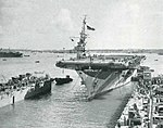 USS Lunga Point (CVE-94) enters a floating drydock at Guam, in May 1945.jpg