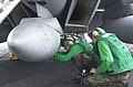US Navy 030113-N-2385R-002 installing the data storage unit into the Shared Reconnaissance Pod.jpg