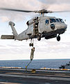US Navy 030210-N-1328C-502 A Sailor assigned to a Explosive Ordnance Disposal (EOD) team embarked aboard USS Theodore Roosevelt (CVN 71) practices Fast Roping.jpg