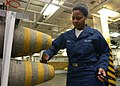 US Navy 030327-N-1328C-511 Aviation Ordnanceman Airman Tamika Brown prepares 2,000-lb bombs for assembly aboard USS Theodore Roosevelt (CVN 71).jpg