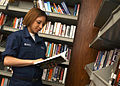 US Navy 030409-N-7672K-003 Seaman Yolanda Munoz from Pharr, Texas, looks for a good book to read among the many available in the ship's library.jpg