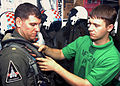 US Navy 030930-N-6293B-001 Aircrew Survival Equipmentman Airman Christopher S. Shows, from Mendenhall, Miss., helps Lt. Cmdr. Steven T. Heumanowski.jpg