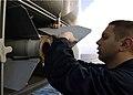 US Navy 041031-N-0499M-041 A Fire Controlman attaches the fin to a RIM-7 NATO Sea Sparrow missile.jpg