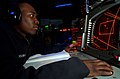 US Navy 041225-N-4757S-228 Operations Specialist Seaman Orlando McCray monitors the Surface Search Radar for other vessels, from the Combat Information Center (CIC) aboard the guided missile cruiser USS Monterey (CG 61).jpg