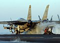 US Navy 050124-N-5345W-077 Final checkers brace themselves from jet blast as an F-14B Tomcat assigned to the Swordsmen of Fighter Squadron Three Two (VF-32) launches down the flight deck aboard the Nimitz-class aircraft carrier.jpg