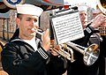 US Navy 050319-N-1161S-007 Sailors from the Atlantic Fleet Band, lead by Navy Musician 1st Class Tom Riddle, plays the National Anthem at a dedication ceremony for the Armed Services at Busch Gardens in Williamsburg, Virginia.jpg
