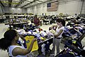 US Navy 050907-N-5328N-083 Volunteers sort through baby clothes at the Hurricane Katrina Evacuee Supply Depot, which is housed in a hangar a the Naval Air Technical Training Center on board Naval Air Station Pensacola, Fla.jpg